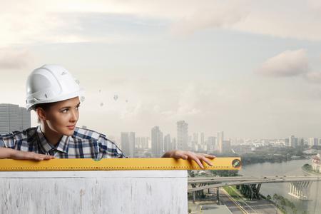 Builder woman taking measures. Mixed media . Mixed media