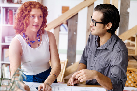 architect drawing: Two young architects in office Stock Photo