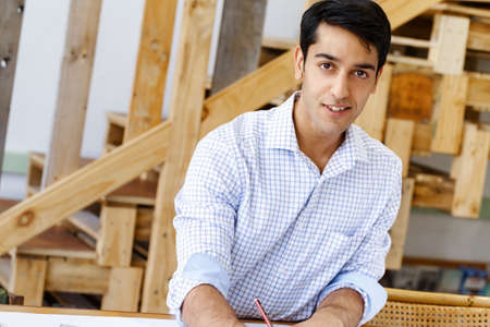 architect drawing: Young man architect in office