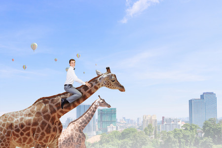 Man ride giraffe