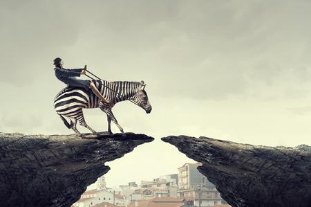 Businesswoman ride zebra Imagens