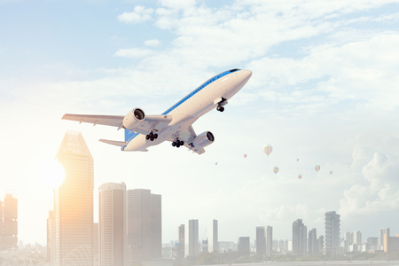 Airplane in day sky. Mixed media Stock Photo