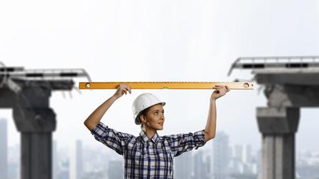 Builder woman taking measures Reklamní fotografie