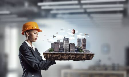 architect: Woman presenting construction model Stock Photo