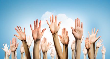 Row of raised hands showing different gestures