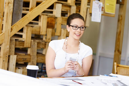 architect: Young woman architect in office