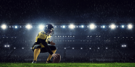 American football players at arena Stock Photo