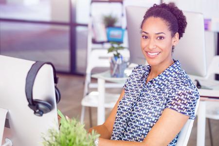 afroamerican: Portrait of smiling afro-american office worker in offfice