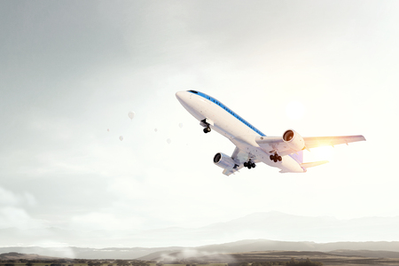 Airliner flying above modern cityscape. Mixed media Stock Photo