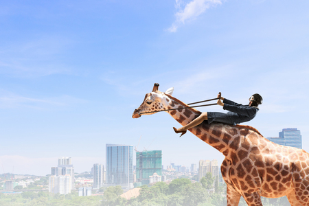Woman ride giraffe
