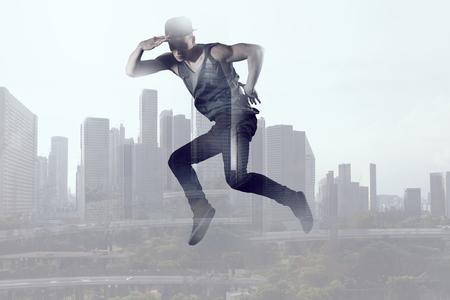 B-boy performing some moves . Mixed media . Mixed media Stock Photo