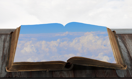 Book with natural cloud landscape on pages Stock Photo