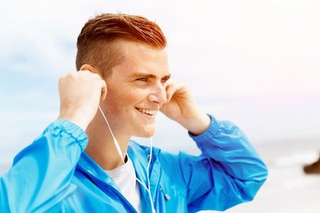 Sports and music. man getting ready for jogging Banco de Imagens - 78540814