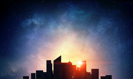 starry night: Sunset above modern city
