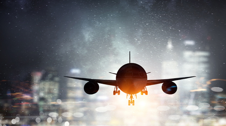 Airliner in night sky Stock Photo
