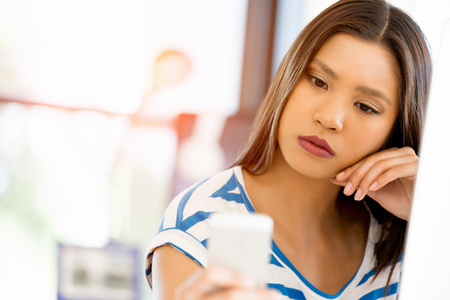 woman on phone: Young woman in office