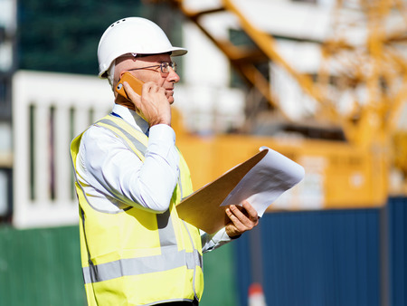 yellow notepad: Engineer builder at construction site