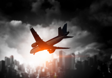 Airliner over cityscape