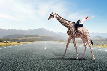Girl saddle giraffe . Mixed media