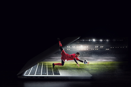Soccer goalkeeper in action. Mixed media Stock Photo