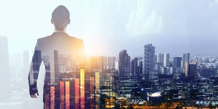 Elegant young businessman against modern cityscape background Stock Photo