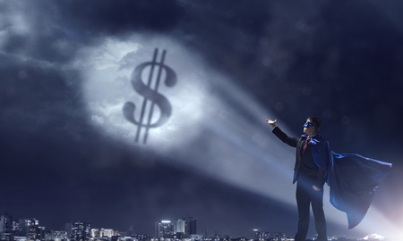 Businessman in cape and mask and glowing dollar sign in air. Mixed media