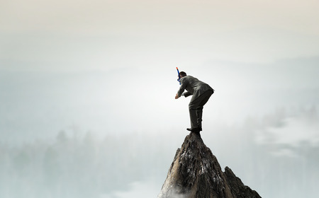Businessman diving from top