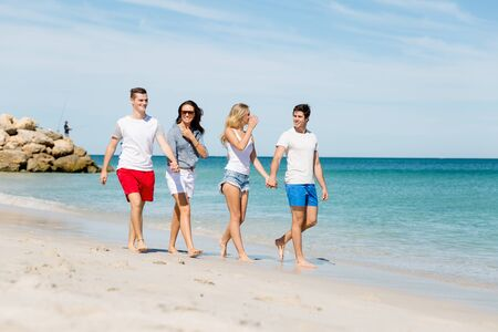 stroll: Company of young people on the beach