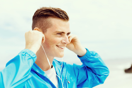 Sports and music. man getting ready for jogging Banco de Imagens - 80056408