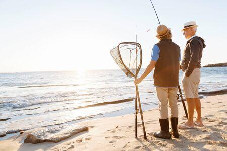 grandkids: Senior man fishing with his grandson