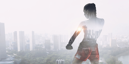 She is fighting for success . Mixed media Stock Photo