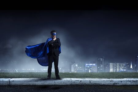 Strong and powerful as super hero . Mixed media Фото со стока