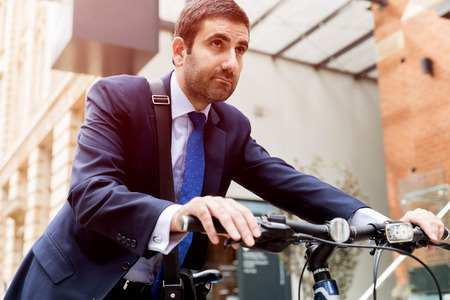 welldressed: Young businessmen with a bike