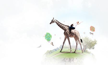 Meisje zadel giraf Stockfoto