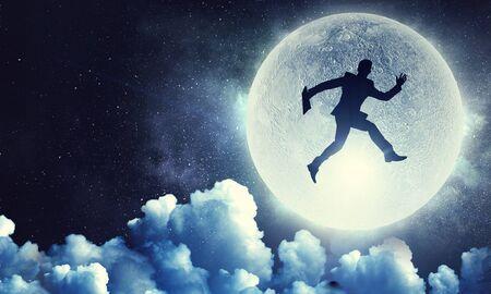 Man and full moon Stock Photo