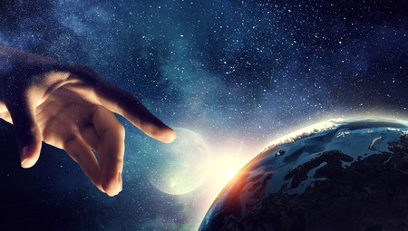 Touching planet with finger Stok Fotoğraf - 80720857