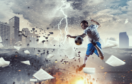 Soccer player in action. Mixed media Stock Photo