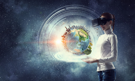 Woman in helmet experiencing virtual reality. Mixed media. Elements of this image are furnished by NASA