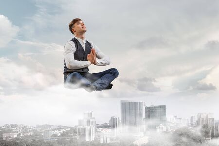 levitate: Take a deep breath and relax Stock Photo
