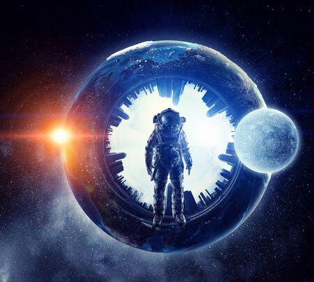 Astronaut in outer space. Mixed media Banco de Imagens