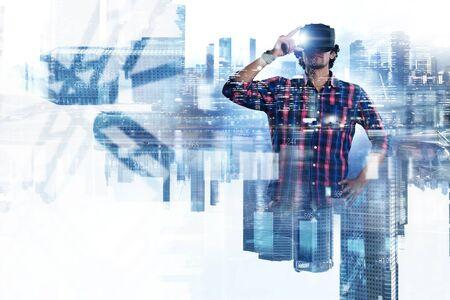 Man in virtual helmet . Mixed media Stock Photo