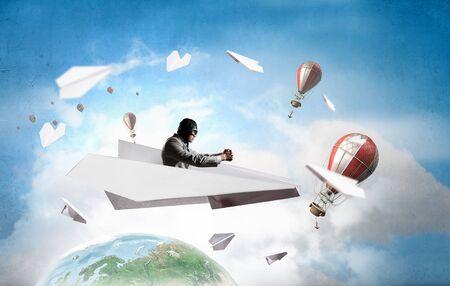 Aviator in origami plane. Mixed media Stock Photo