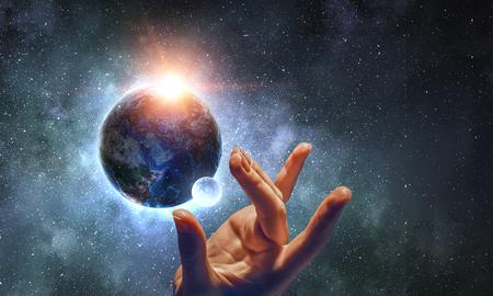 指で惑星に触れる 写真素材