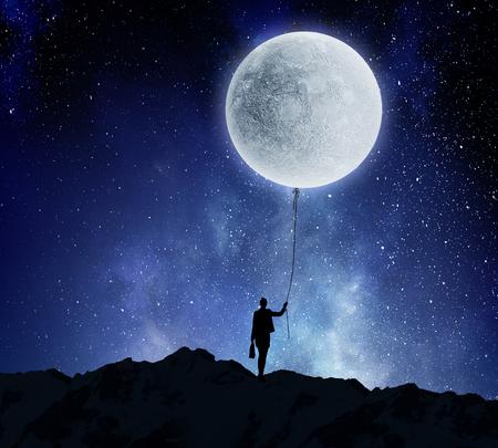 Woman catching moon . Mixed media