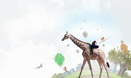 mixed media: Girl saddle giraffe . Mixed media