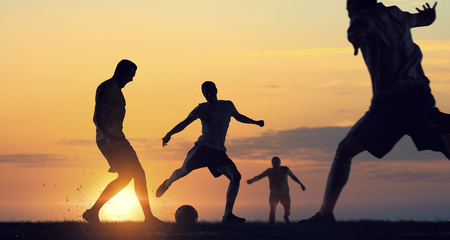 Silhouettes of soccer players Stock Photo