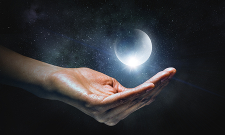 Moon planet lying on palm Stock fotó