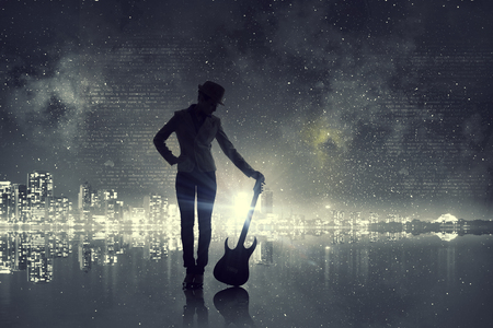 Silhouette of rock babe with electric guitar in hands. Mixed media
