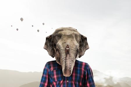 Man in casual with elephant head. Mixed media Reklamní fotografie