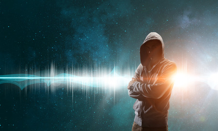 Young man in hood against night sky background